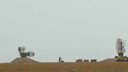 Working military radar in a deserted field