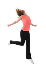 young attractive red hair woman jumping in healthy lifestyle