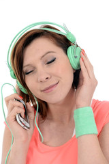 woman with cell phone and headphones listening music