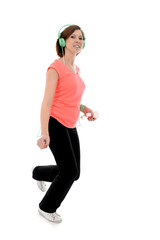 young attractive woman jogging with headphones and cell phone