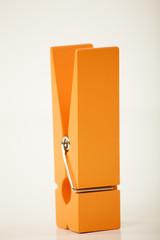 oversized orange clothes pin