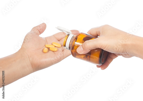 hands with pills and pill container