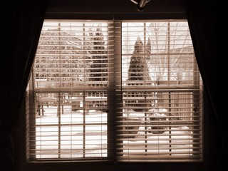 View from window outside to the deck with snow