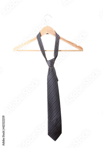 Elegant grey tie on wooden hanger isolated on white