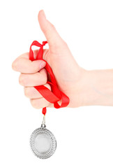 Silver medal in hand isolated on white