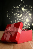 Open gift box on dark background