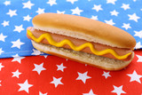 Tasty hot dog on napkin with stars, isolated on white