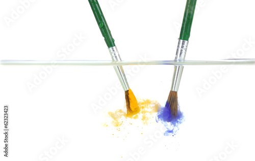 Brushes with color paint in water