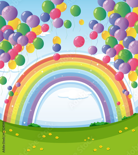 A sky with a rainbow and a group of floating balloons