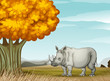 A rhinoceros near the tree