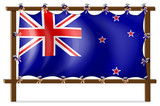 The flag of New Zealand tied to a wooden frame
