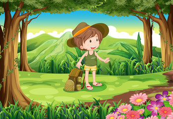 A lady with a backpack and a hat at the forest