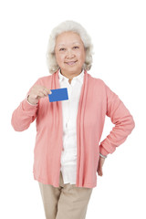 .Senior woman holding name card.