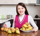 Happy  housewife with pears
