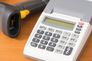 one cash register with a barcode reader