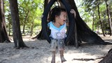 thai child on a tire swing