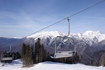 chairlift in Caucasian mountains at winter