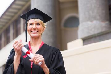 senior graduate holding certificate