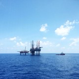 Oil and Gas Platform with a standby vessel nearby