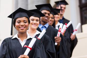 group of university graduates at graduation