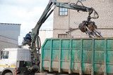 Machine Loader with Hydraulic Crab Bucket uploads Waste Steel
