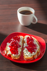 Sandwiches with cottage cheese and cranberry jam fot breakfast