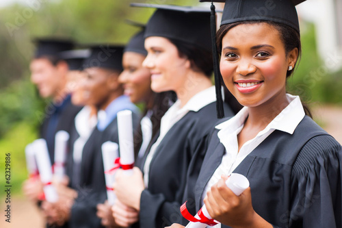 pretty african female college graduate at graduation - 62329886