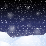 Falling snow against the dark night sky.