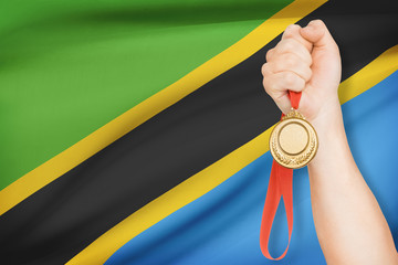 Medal in hand with flag - United Republic of Tanzania