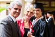 female college graduate with parents