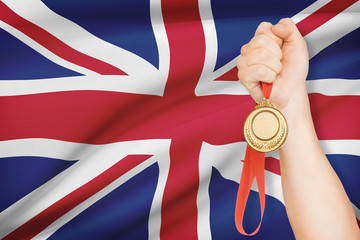 Medal in hand with flag - United Kingdom