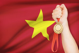 Medal in hand with flag - Socialist Republic of Vietnam