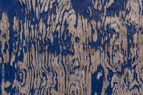 Abstract close up of peeling paint on wood texture