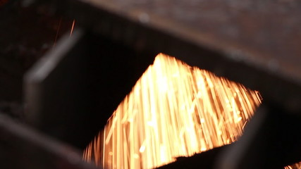 Heavy industry - The industrial laser cuts a metal sheet.