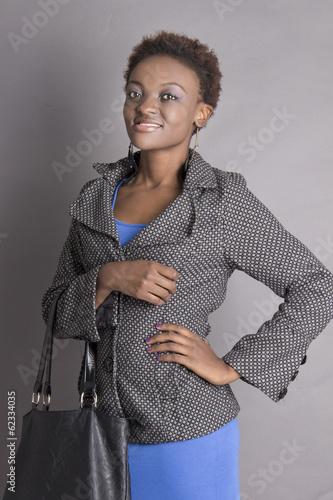 Pretty Young Black Woman holding her handbag