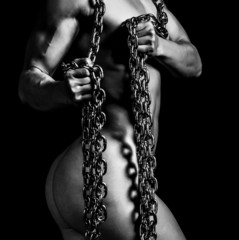 Muscled woman with a metal chain