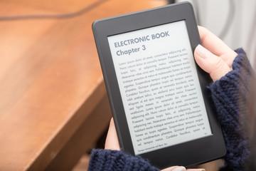 Reading a book with an e-book reader