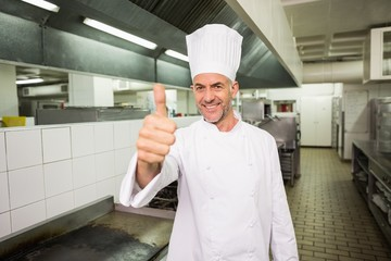Happy chef looking at the camera giving thumbs up
