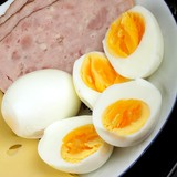 half boiled eggs with ham and cheese