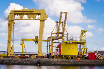 Horizontal color image of heavy machinery in docks.