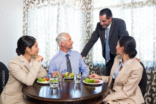 Business colleagues having meal together