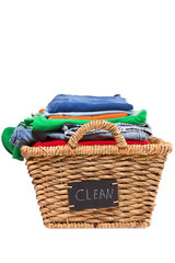 Wicker laundry basket filled with clean clothes