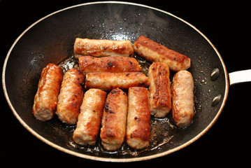 Breakfast Sausage Links Frying in a Pan