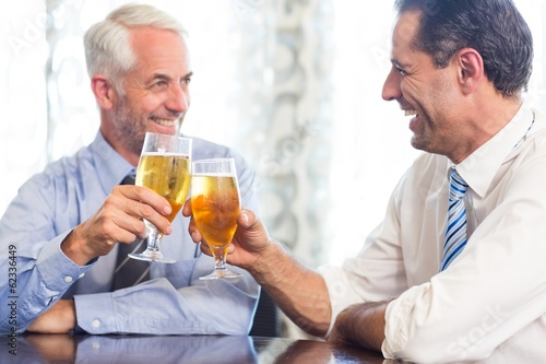 Business colleagues toasting beer glasses