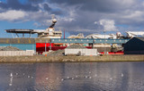 Horizontal color image of cargo ship in Edinburgh docks.