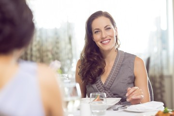Beautiful smiling woman at meal table