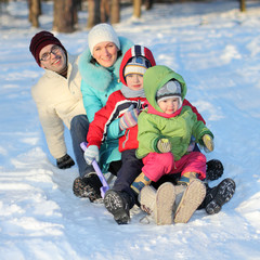 young family sledding