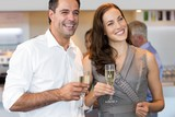 Cheerful couple with champagne flutes