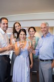 Happy people holding champagne flutes