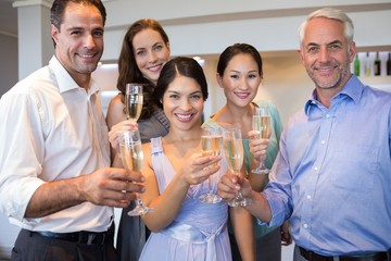 People holding champagne flutes